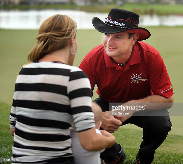 Rory Sabbatini talks briefly to his wife Amy during the Honda Classic in Palm Beach Gardens Florida on Sunday March 6 2011