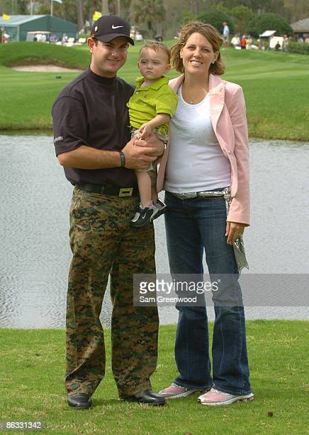 Rory Sabbatini with son Harley Aiden and wife Amy wearing camouflage pants in support of the troops in Afghanistan and Iraq during practice for THE...