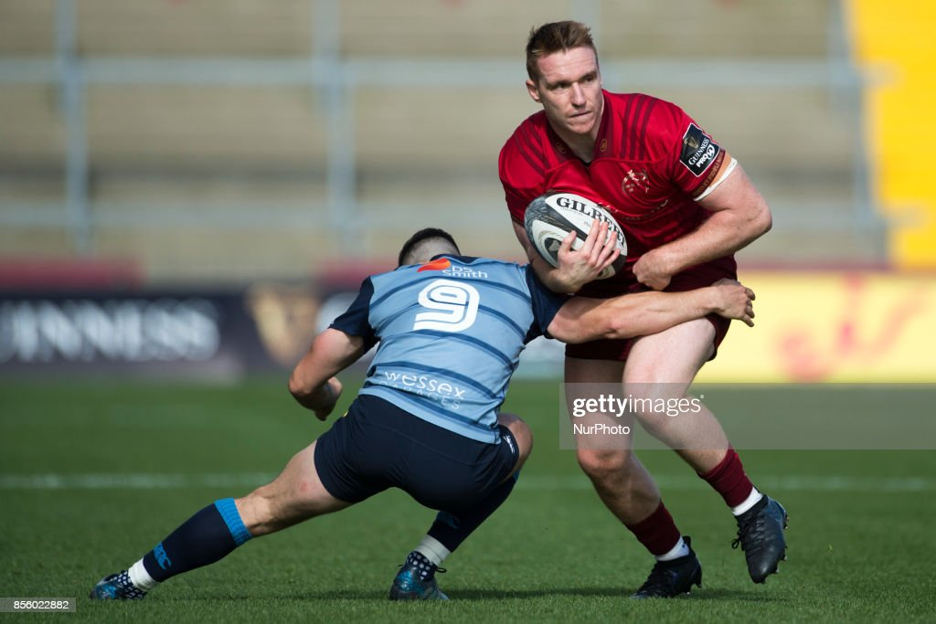 Rory Scannell of Munster tackled by Tomos Williams of Cardiff during the Guinness PRO14 Conference A Round 5 match between Munster Rugby and Cardiff Blues at Thomond Park in Limerick, Ireland on September 30, 2017