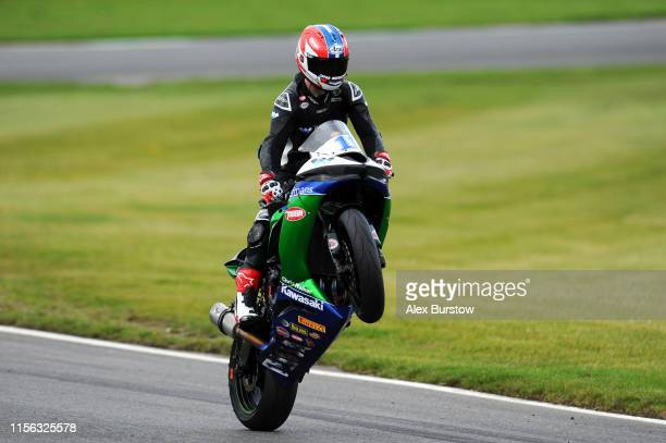 Rory Skinner of Great Britain pulls a wheelie after the Dickies British Supersport Championship and British GP2 Cup race at Brands Hatch on June 16,...