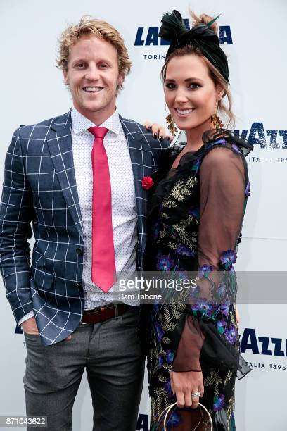 Rory Sloane and Belinda Riverso poses at the Lavazza Marquee on Melbourne Cup Day at Flemington Racecourse on November 7 2017 in Melbourne Australia