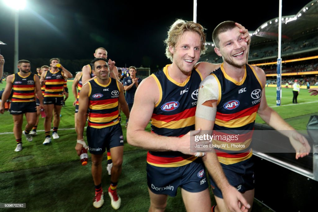 Rory Sloane and Bryce Gibbs of the Crows celebrate their win during the 2018 AFL round 02 match between the Adelaide Crows and the Richmond Tigers at Adelaide Oval on March 29, 2018 in Adelaide, Australia.