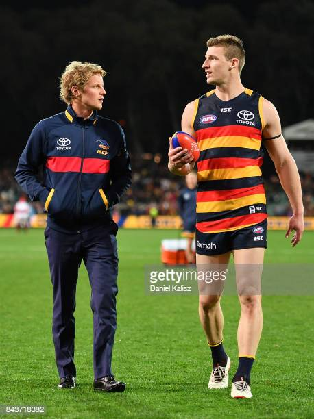 Rory Sloane and Josh Jenkins of the Crows walk from the field after the AFL First Qualifying Final match between the Adelaide Crows and the Greater...