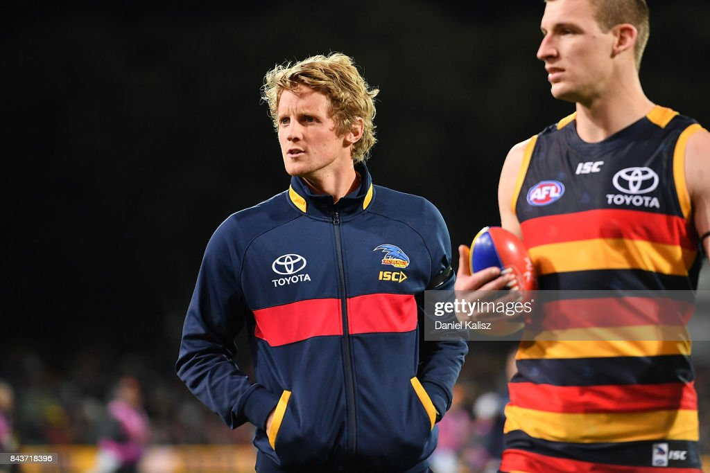 Rory Sloane and Josh Jenkins of the Crows walk from the field after the AFL First Qualifying Final match between the Adelaide Crows and the Greater Western Sydney Giants at Adelaide Oval on September 7, 2017 in Adelaide, Australia.