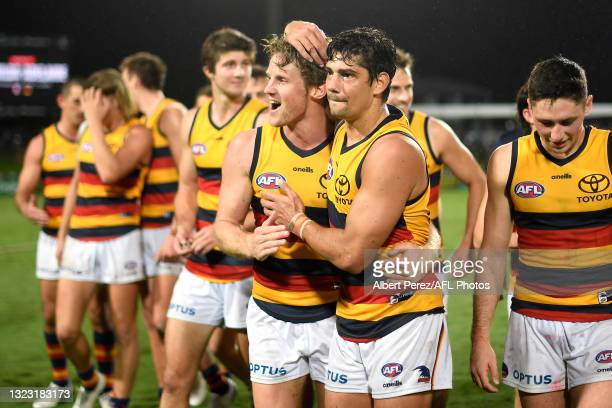 Rory Sloane and Shane McAdam of the Crows celebrate after their victory during the round 13 AFL match between the St Kilda Saints and the Adelaide...