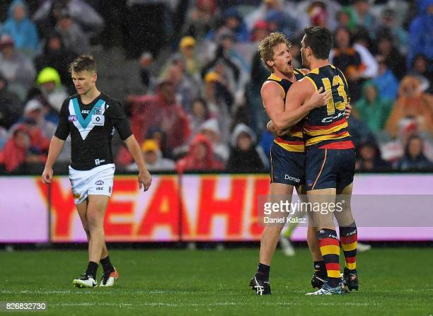 Rory Sloane and Taylor Walker of the Crows celebrate during the round 20 AFL match between the Adelaide Crows and the Port Adelaide Power at Adelaide...