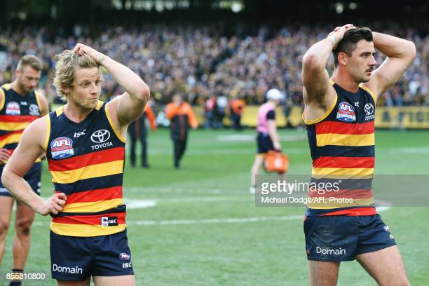 Rory Sloane and Taylor Walker of the Crows looks dejected after defeat during the 2017 AFL Grand Final match between the Adelaide Crows and the...