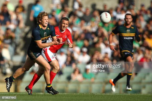 Rory Sloane of Australia hand passes during game two of the International Rules Series between Australia and Ireland at Domain Stadium on November 18...