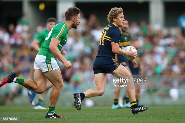 Rory Sloane of Australia runs the ball during game two of the International Rules Series between Australia and Ireland at Domain Stadium on November...