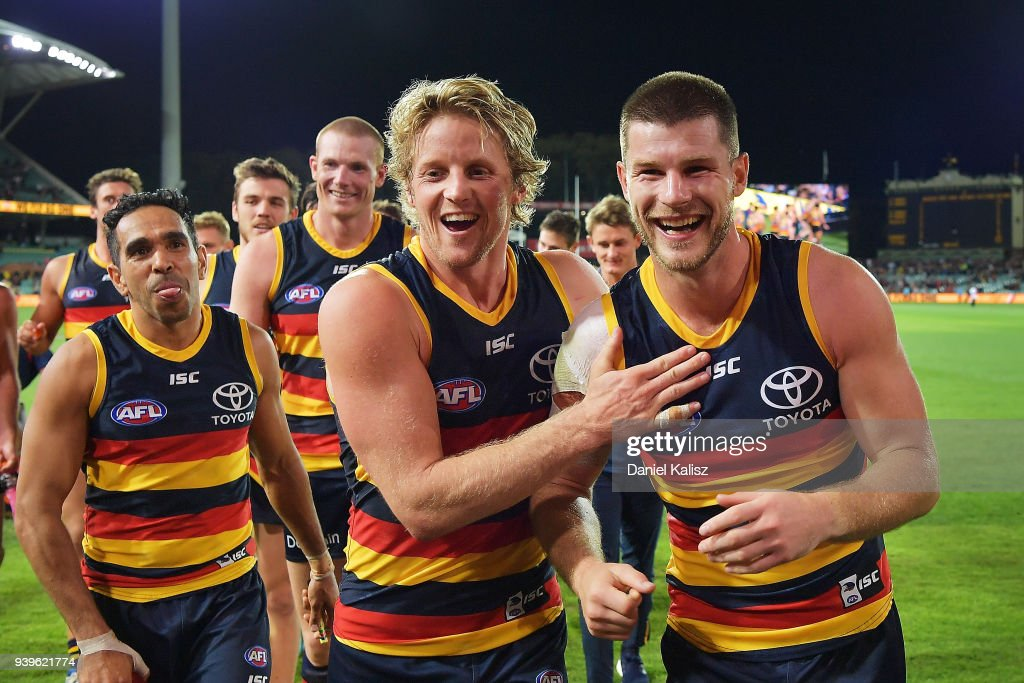 Rory Sloane of the Crows and Bryce Gibbs of the Crows walk from the field during the round two AFL match between the Adelaide Crows and the Richmond Tigers at Adelaide Oval on March 29, 2018 in Adelaide, Australia.