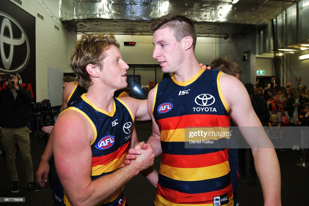 Rory Sloane of the Crows and Josh Jenkins of the Crows celebrate after the round 15 AFL match between the Adelaide Crows and the West Coast Eagles at Adelaide Oval on June 30, 2018 in Adelaide, Australia.