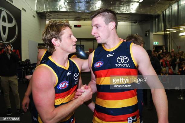 Rory Sloane of the Crows and Josh Jenkins of the Crows celebrate after the round 15 AFL match between the Adelaide Crows and the West Coast Eagles at...