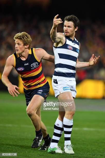 Rory Sloane of the Crows and Patrick Dangerfield of the Cats compete for the ball during the round 18 AFL match between the Adelaide Crows and the...