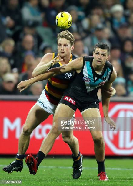 Rory Sloane of the Crows and Ryan Burton of the Power during the 2021 AFL Round 08 match between the Port Adelaide Power and the Adelaide Crows at...
