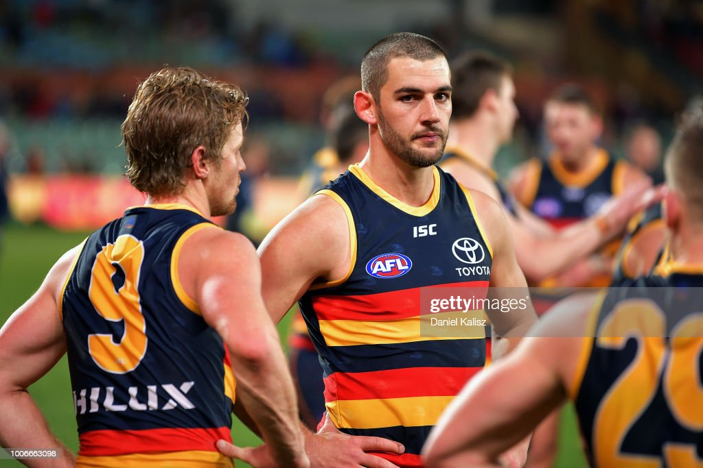 Rory Sloane of the Crows and Taylor Walker of the Crows look on dejected after the final siren during the round 19 AFL match between the Adelaide Crows and the Melbourne Demons at Adelaide Oval on July 28, 2018 in Adelaide, Australia.