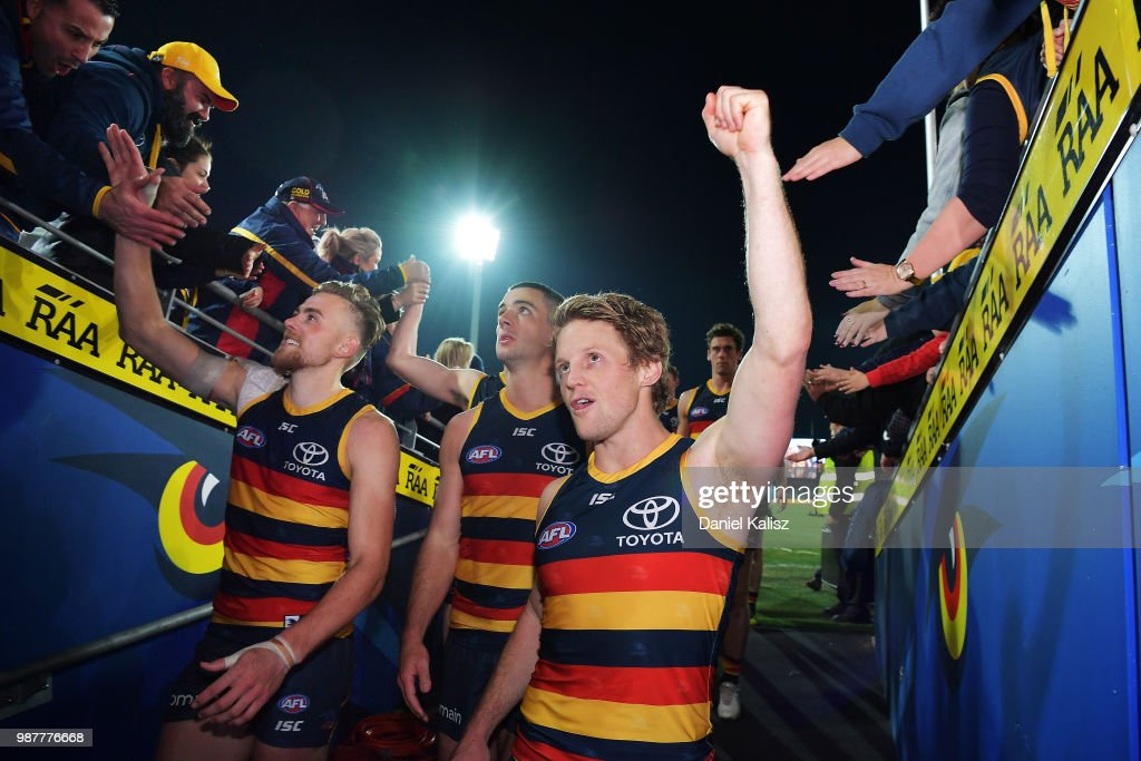 Rory Sloane of the Crows celebrates with fans after the round 15 AFL match between the Adelaide Crows and the West Coast Eagles at Adelaide Oval on June 30, 2018 in Adelaide, Australia.