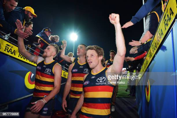 Rory Sloane of the Crows celebrates with fans after the round 15 AFL match between the Adelaide Crows and the West Coast Eagles at Adelaide Oval on...