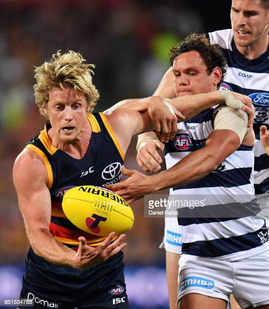 Rory Sloane of the Crows competes for the ball with Steven Motlop of the Cats during the First AFL Preliminary Final match between the Adelaide Crows...