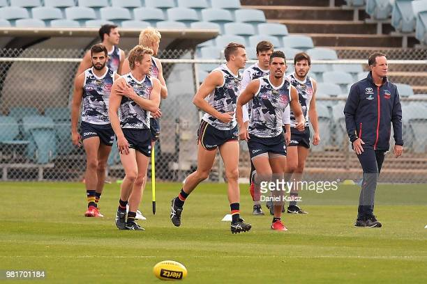 Rory Sloane of the Crows, Curly Hampton of the Crows and Adelaide Crows Senior Coach Don Pyke look on during a training session prior to a press...