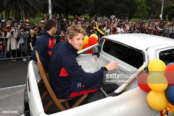 Rory Sloane of the Crows is driven through the city during the 2017 AFL Grand Final Parade ahead of the Grand Final between the Adelaide Crows and...