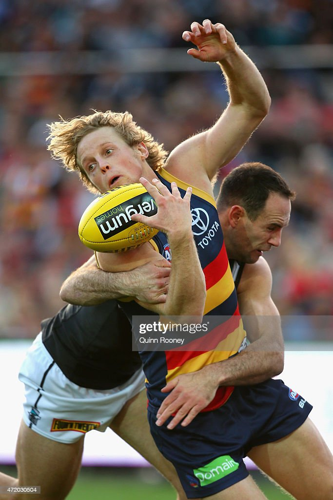 Rory Sloane of the Crows is tackled by Matthew Broadbent of the Power during the round five AFL match between the Adelaide Crows and the Port Adelaide Power at Adelaide Oval on May 3, 2015 in Adelaide, Australia.