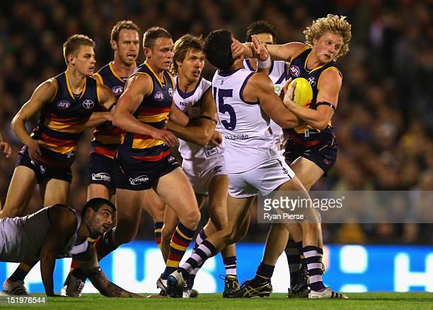 Rory Sloane of the Crows is tackled by Ryan Crowley of the Dockers during the AFL Second Semi Final match between the Adelaide Crows and the...