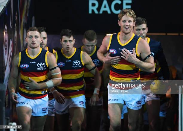 Rory Sloane of the Crows leads his team out of their race during the round eight AFL match between the Port Adelaide Power and the Adelaide Crows at...