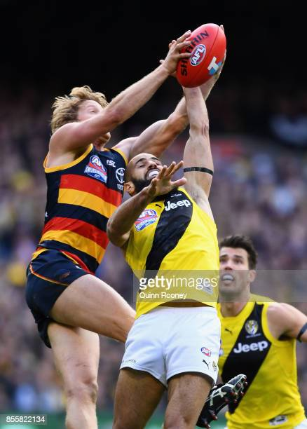 Rory Sloane of the Crows marks over the top of Bachar Houli of the Tigers during the 2017 AFL Grand Final match between the Adelaide Crows and the...