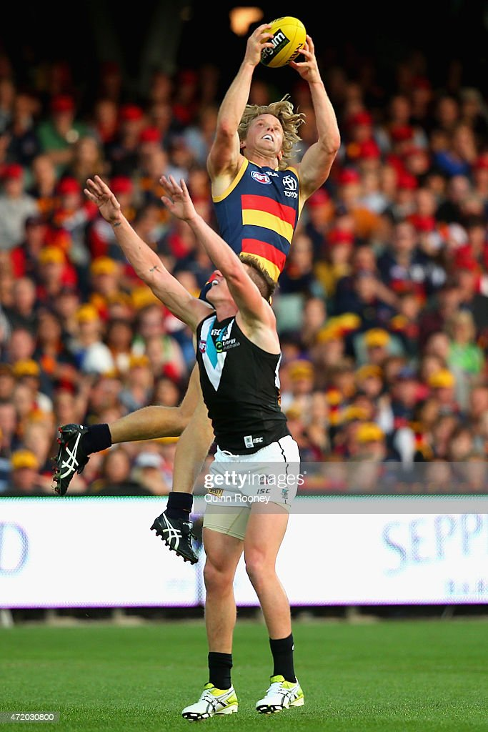 Rory Sloane of the Crows marks over the top of Matt White of the Power during the round five AFL match between the Adelaide Crows and the Port Adelaide Power at Adelaide Oval on May 3, 2015 in Adelaide, Australia.