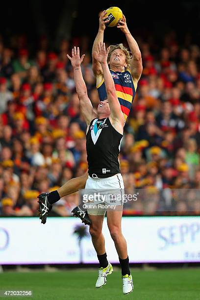 Rory Sloane of the Crows marks over the top of Matt White of the Power during the round five AFL match between the Adelaide Crows and the Port...