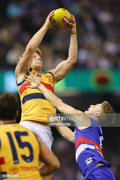 Rory Sloane of the Crows marks the ball against Lachie Hunter of the Bulldogs during the round seven AFL match between the Western Bulldogs and the...