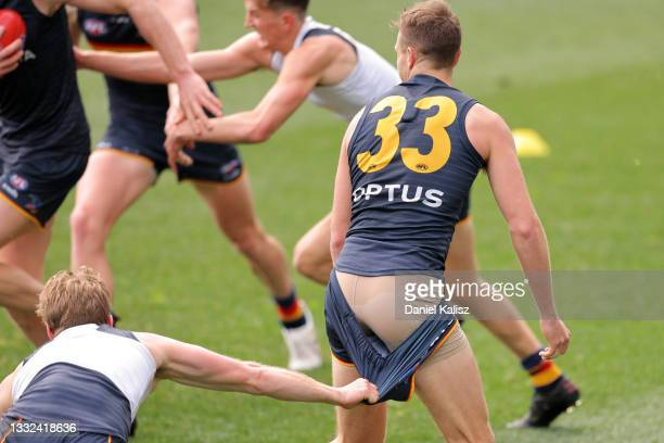 Rory Sloane of the Crows tackles Brodie Smith of the Crows during an Adelaide Crows AFL training session at Adelaide Oval on August 05, 2021 in...