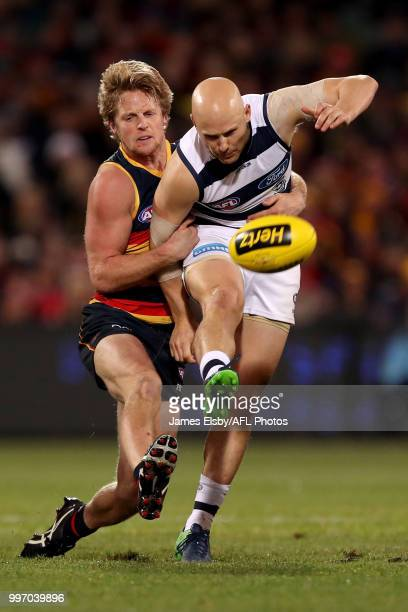 Rory Sloane of the Crows tackles Gary Ablett of the Cats during the 2018 AFL round 17 match between the Adelaide Crows and the Geelong Cats at...