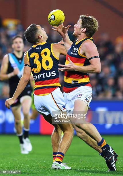 Rory Sloane of the Crows takes the ball off Lachlan Sholl of the Crows during the round eight AFL match between the Port Adelaide Power and the...