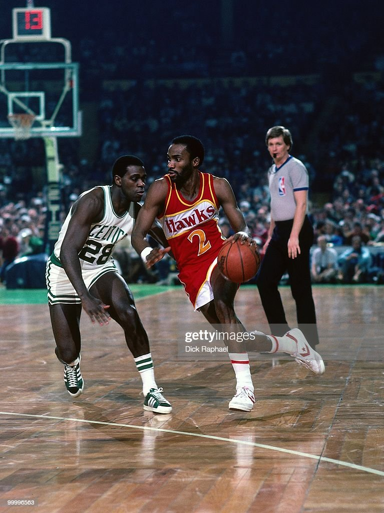 Rory Sparrow #2 of the Atlanta Hawks drives to the basket against Quinn Buckner #28 of the Boston Celtics during a game played in 1983 at the Boston Garden in Boston, Massachusetts.