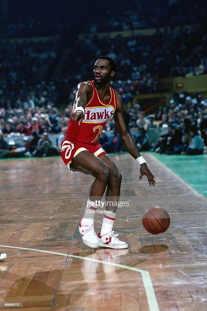 Rory Sparrow #2 of the Atlanta Hawks moves the ball up court against the Boston Celtics during a game played in 1983 at the Boston Garden in Boston, Massachusetts.