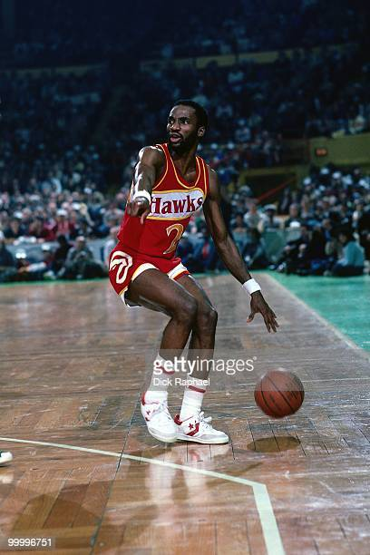Rory Sparrow of the Atlanta Hawks moves the ball up court against the Boston Celtics during a game played in 1983 at the Boston Garden in Boston...