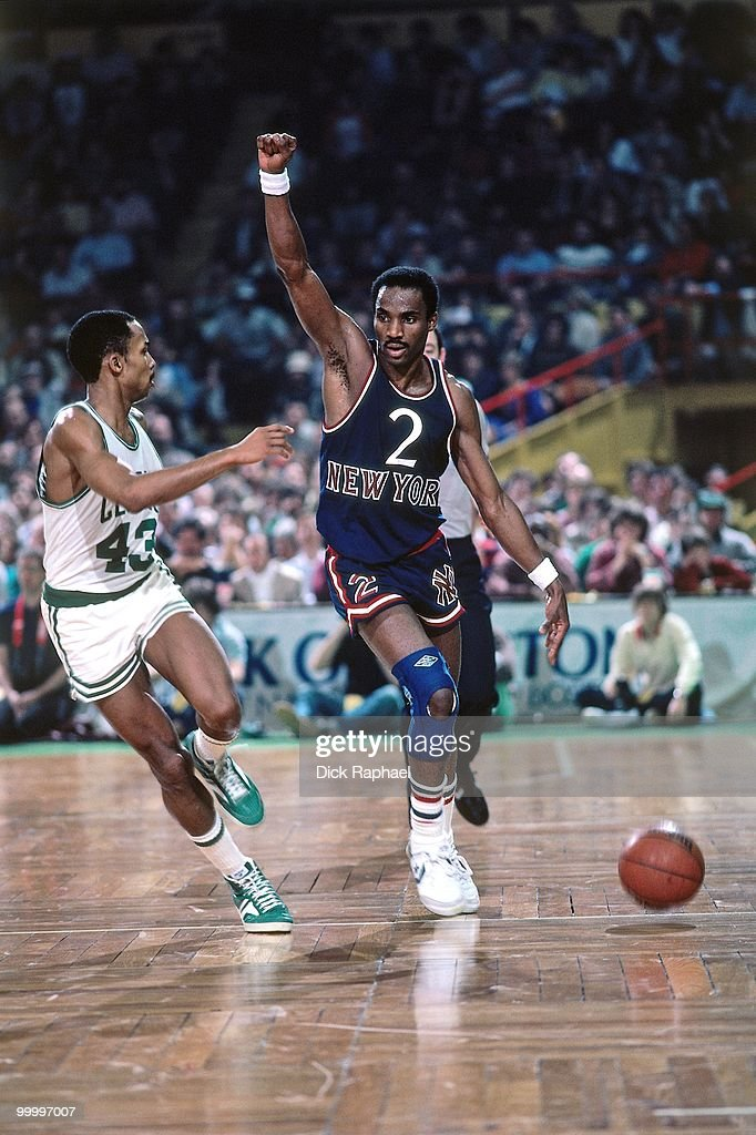 Rory Sparrow #2 of the New York Knicks moves the ball up court against Gerald Henderson #43 of the Boston Celtics during a game played in 1983 at the Boston Garden in Boston, Massachusetts.