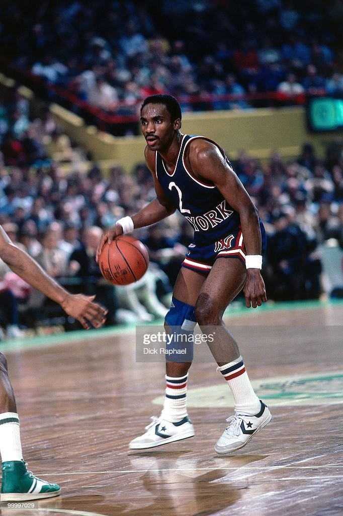 Rory Sparrow #2 of the New York Knicks moves the ball up courut against the Boston Celtics during a game played in 1983 at the Boston Garden in Boston, Massachusetts.