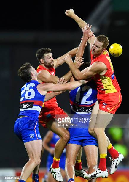 Rory Thompson and Jordan Murdoch of the Suns contest the ball with Billy Gowers and Zaine Corey of the Bulldogs during the 2019 JLT Community Series...