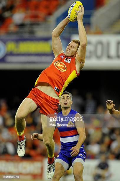 Rory Thompson of the Suns marks during the round eight AFL match between the Gold Coast Suns and the Western Bulldogs at Metricon Stadium on May 18...