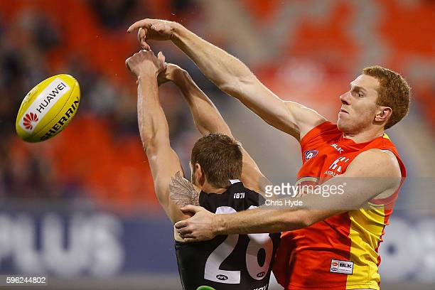 Rory Thompson of the Suns spoils a mark from Jay Shultz of the Power during the round 23 AFL match between the Gold Coast Suns and the Port Adelaide...