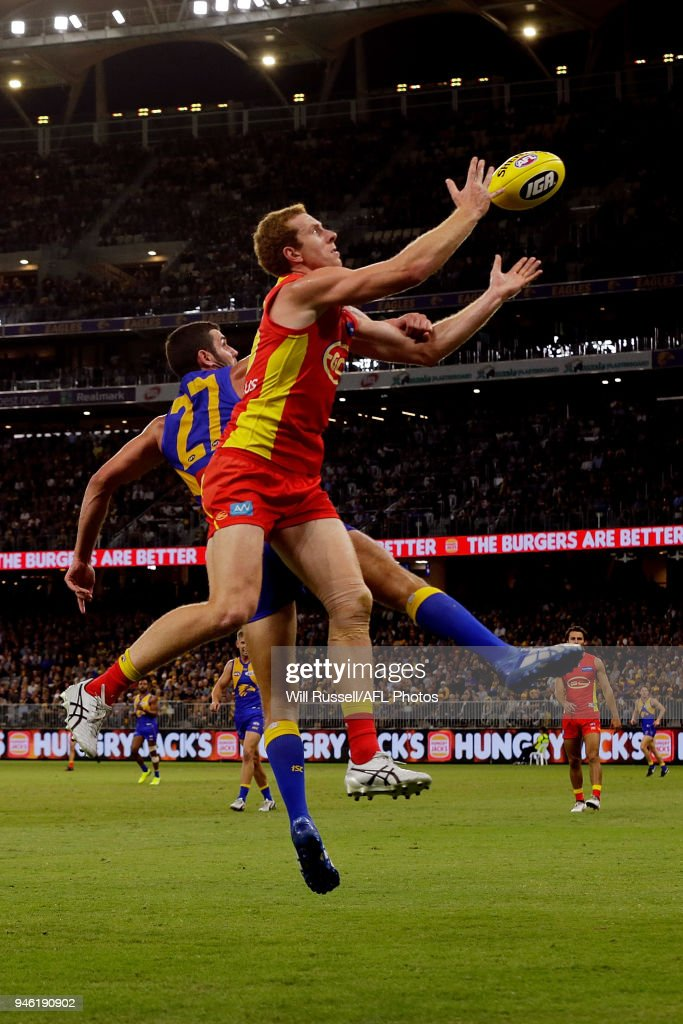 Rory Thompson of the Suns takes an overhead mark during the round four AFL match between the West Coast Eagles and the Gold Coast Suns at Optus Stadium on April 14, 2018 in Perth, Australia.