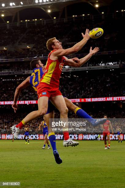 Rory Thompson of the Suns takes an overhead mark during the round four AFL match between the West Coast Eagles and the Gold Coast Suns at Optus...