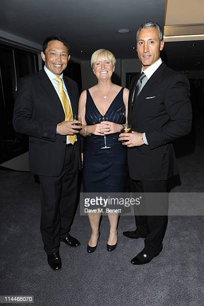 Rory Underwood and wife with Andreas Panayiotou attends the 'London Syon Park A Waldorf Astoria Hotel' Grand Opening party on May 19 2011 in London...