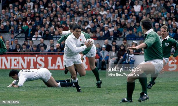 Rory Underwood of England comes inside to attack the Ireland defence during the Inaugural Millennium Trophy rugby match between Ireland and England...