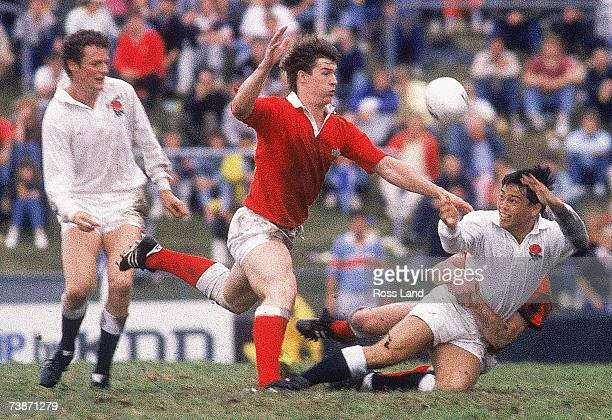 Rory Underwood of England gets a pass away in a tackle during the 1987 Rugby World Cup QuarterFinal match between Wales and England at Ballymore...