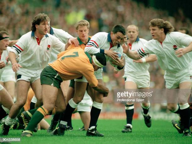 Rory Underwood of England is tackled by Willie Ofahengane of Australia during the Rugby Union World Cup Final at Twickenham in London on 2nd November...