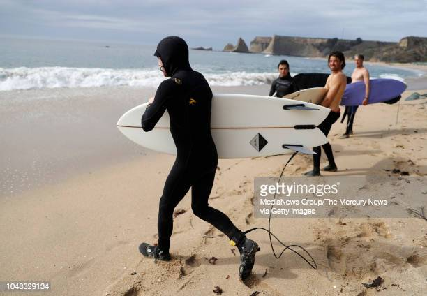 Rory who did not want to give his last name heads out to the water to surf at Martins Beach in Half Moon Bay Calif on Monday Oct 1 2018