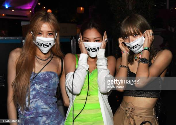 Rosé Jisoo and Lisa of Black Pink are seen backstage as Ariana Grande performs at Coachella Stage during the 2019 Coachella Valley Music And Arts...